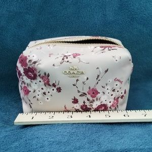 Small Floral Print Coach Cosmetic Case.